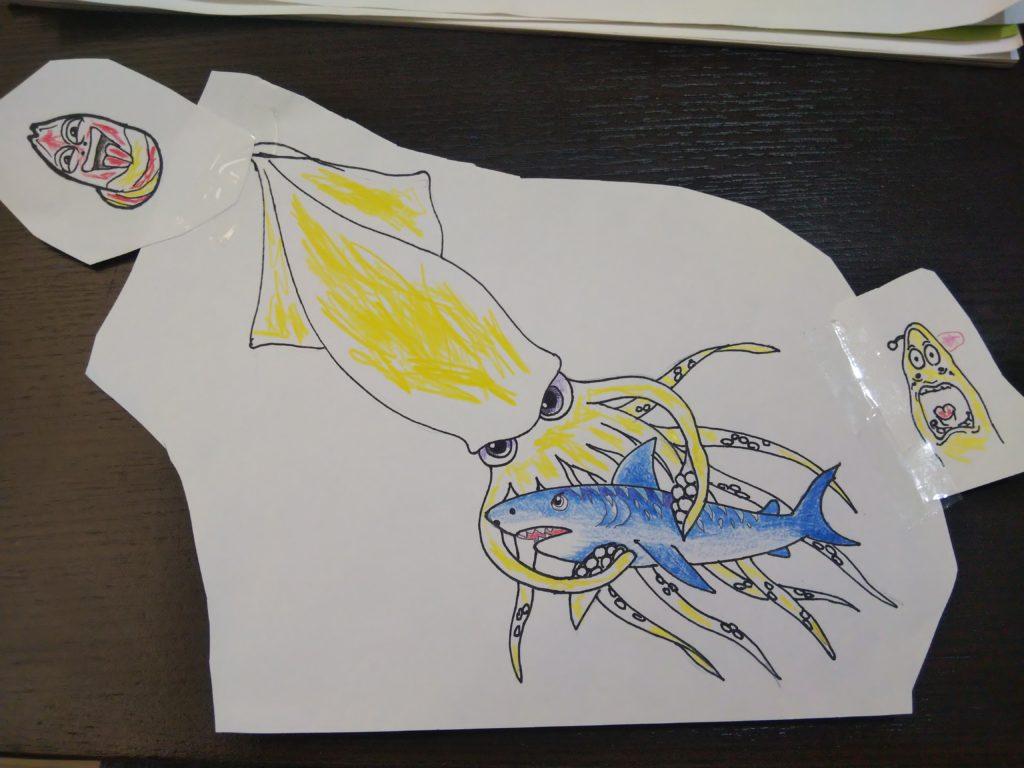 ダイオウイカとイタチザメ